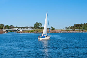 A sailboat  is afloat near Hevossalmi bridge (Helsinki, FI)