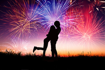 loving young couple with fireworks background