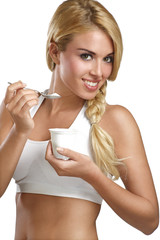 beautiful woman eating fresh yogurt for breakfast