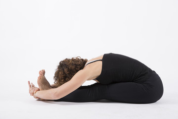 yoga posture seated forward bend pose white background