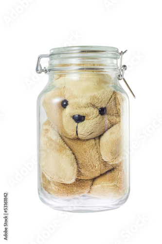 Teddy bear in a glass jar