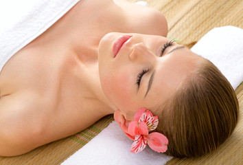 Facial spa therapy. Beautiful young female model getting massage