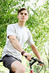 young guy on bicycle