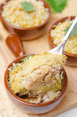 portioned form with baked chicken with mashed cauliflower