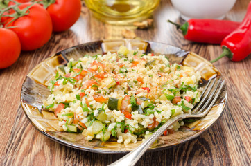 salad with bulgur, zucchini, tomatoes and parsley