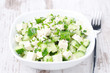 salad with cucumber, tofu, green onions and sesame seeds