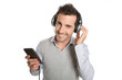 Cheerful man listening to music with headphones