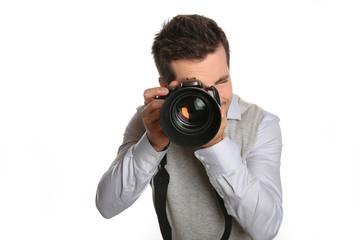 Portrait of photographer holding digital camera