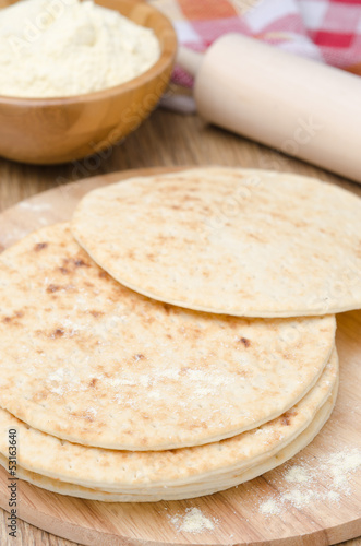 wheat tortillas on a wooden board selective focus