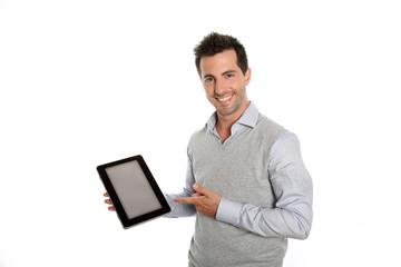 Startup businessman showing tablet screen