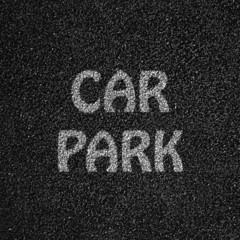Black road texture with the words car park write on it