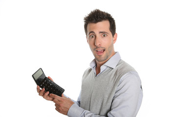 Worried man showing bad figures on calculator