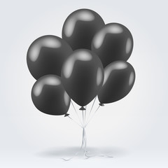 Bunch of black glossy inflatable balloons