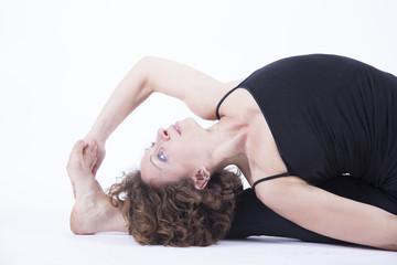 yoga janushirshana D head to knee pose side view close up