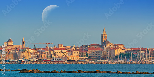 Alghero at sunset under the moon