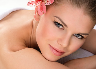 Attractive young woman relaxing. Spa/ wellness concept.