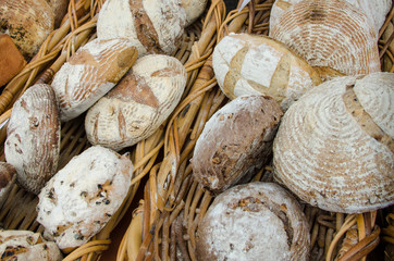 Close up of fresh baked breads in wicker baskets.