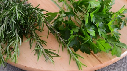rosemary and parsley on cutting board