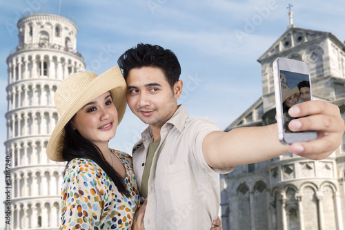 Asian couple travel and take picture at Rome