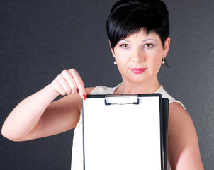 serious business woman with blank over dark background