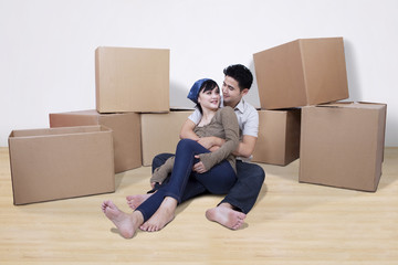 Asian couple with boxes at home