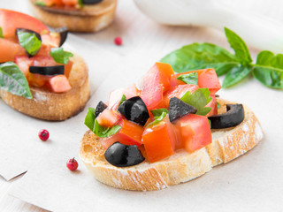 Classic Italian appetizer bruschetta with tomato, basil and blac
