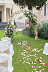 Beautiful wedding gazebo with flower arrangements decorating
