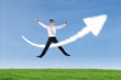 Businessman jumping and give thumbs up over success sign
