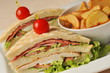 Fresh triple decker hotel club sandwich with french fries
