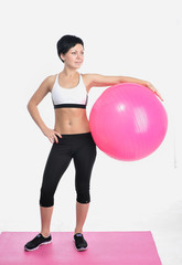 Young woman with a fitness ball