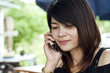 Beautiful Asian woman using mobile phone.