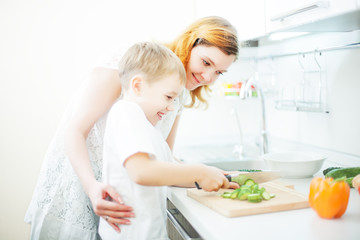 Happy mother and son cooking