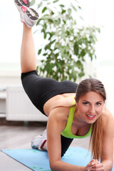 Beautiful woman working out at home