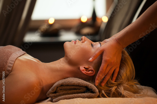 Beautiful young woman enjoys massage