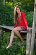 Beautiful long-haired girl sitting
