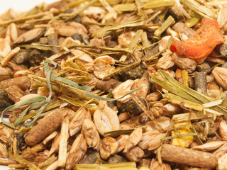 basic muesli  with herbs for horse background. close up