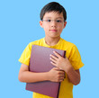 Boy Holding a Thick Red Book