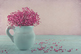 Pink baby's breath flowers in a blue jug