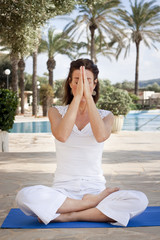 Woman meditating in lotus yoga