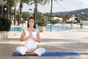 Woman meditating in lotus yoga