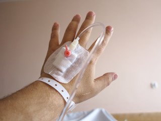 Patient's hand in the hospital with an IV