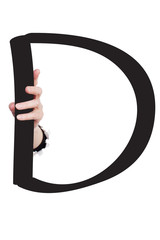 Hand breaking paper surface holding letter 'D'