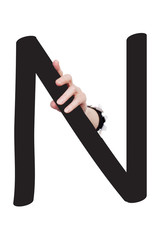 Hand breaking paper surface holding letter 'N'