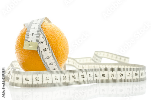 Fresh orange with measuring tape
