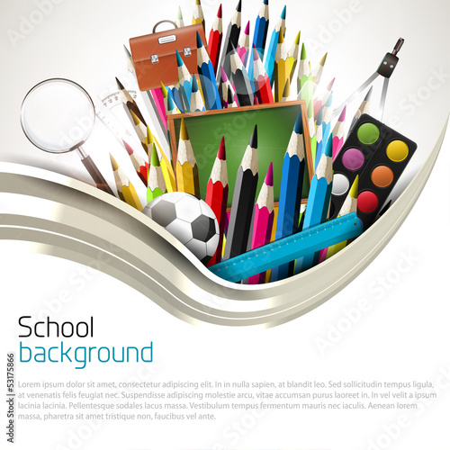 Colorful crayons with school supplies - school background
