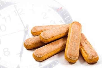 ladyfinger biscuits on clock's background