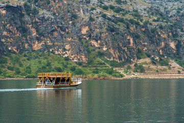 Wooden Boat Carries Tourists
