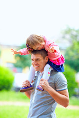 happy father and baby girl having fun outdoors