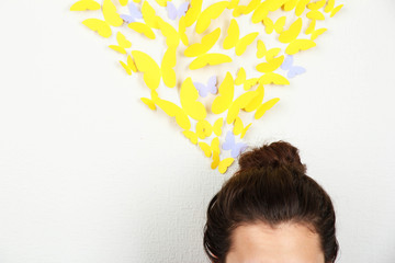 Paper yellow butterflies fly thoughts out of head