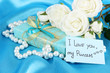 Romantic parcel on blue cloth background